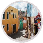 Round Beach Towel featuring the photograph Downhill Narrow Street In Guanajuato, Mexico 2 by Tatiana Travelways