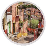 Round Beach Towel featuring the photograph Downhill Narrow Street In Guanajuato, Mexico by Tatiana Travelways