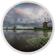 Round Beach Towel featuring the photograph Dramatic Sky Over Three Windmills In Holland by IPics Photography