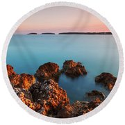 Round Beach Towel featuring the photograph Ember And Blue by Davor Zerjav