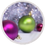 Round Beach Towel featuring the photograph Festive Scene For Christmas With Xmas Balls And Lights In Backgr by Cristina Stefan