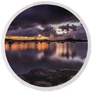 First Light With Heavy Rain Clouds On The Bay Round Beach Towel