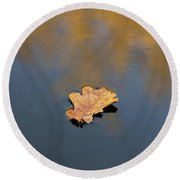 Round Beach Towel featuring the photograph Golden Leaf On Water by Scott Lyons