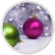 Round Beach Towel featuring the photograph Green And Fuchsia Christmas Balls And Lights In Background. Wint by Cristina Stefan