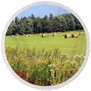 Round Beach Towel featuring the photograph Hay Bails And Wild Flowers by Tatiana Travelways