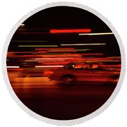High Speed Traffic On A Road At Night Round Beach Towel