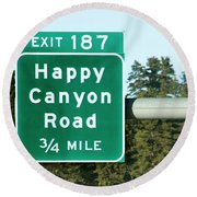 Highway Sign For Happy Canyon Road Round Beach Towel