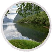 Round Beach Towel featuring the photograph Hiking The Old Postal Road By The Naeroyfjord, Norway by Andreas Levi