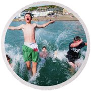 Jetty Jumping Into The Sea Round Beach Towel
