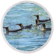 Round Beach Towel featuring the painting King Penguins Swimming by Alan M Hunt