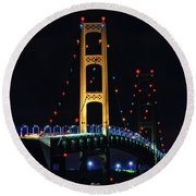 Round Beach Towel featuring the photograph Mackinac Bridge Lit Up by Dan Sproul