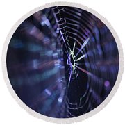 Macro Of A Spiders Web Captured At Night. Round Beach Towel