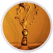 Round Beach Towel featuring the photograph Molten Caramel Water Drop Collision by SR Green