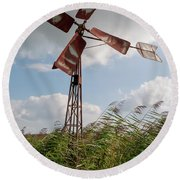 Round Beach Towel featuring the photograph Old Rusty Windmill. by Anjo Ten Kate