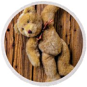 Old Teddy Bear Hanging On The Door Round Beach Towel