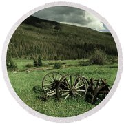 Old Wagon Axles And Colorado Mountains Round Beach Towel