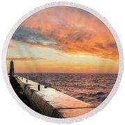 Orange Skies Over Frankfort Lighthouse Round Beach Towel