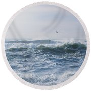 Round Beach Towel featuring the photograph Reynisfjara Seagull Over Crashing Waves by Nathan Bush