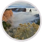 Rim Rock Drive View Of Fogged Independence Canyon Round Beach Towel