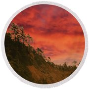 Silhouette Of Conifer Against  Seacoast  Round Beach Towel