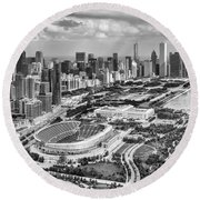 Round Beach Towel featuring the photograph Soldier Field And Chicago Skyline Black And White by Adam Romanowicz