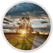 Sunset On The Field Round Beach Towel