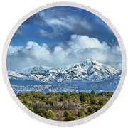 The City Of Bariloche Surrounded By Mountains Round Beach Towel