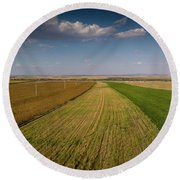 Round Beach Towel featuring the photograph The Colored Fields by Okan YILMAZ