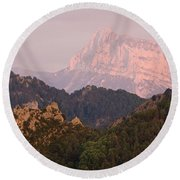 Round Beach Towel featuring the photograph The Last Of The Light At Pena Montanesa by Stephen Taylor