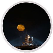 The Moon Is Seen Rising Behind The Space Shuttle Endeavour On Pad 39a Round Beach Towel