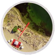 Round Beach Towel featuring the photograph The Red by Okan YILMAZ