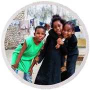 Round Beach Towel featuring the photograph The Zanzibar Girls by Kay Brewer