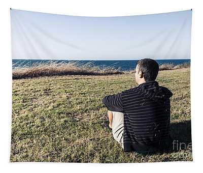 Caucasian Traveler Relaxing On Grass Outdoors Tapestry