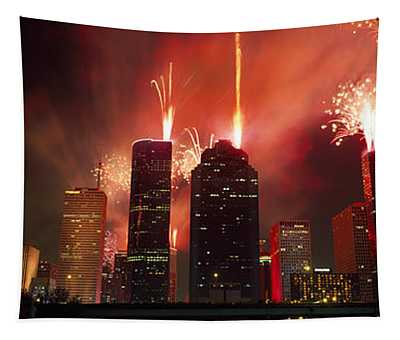 Fireworks Over Buildings In A City Tapestry