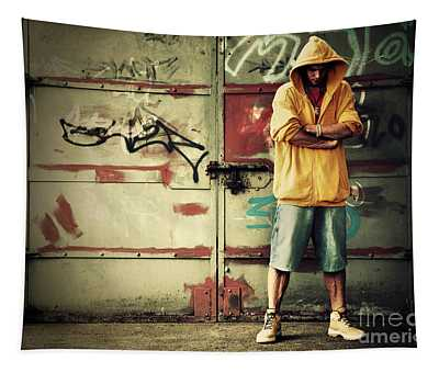 Young Man In Hooded Sweatshirt On Grunge Wall Tapestry