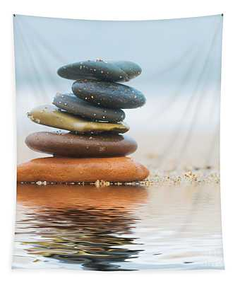 Stack Of Beach Stones On Sand Tapestry