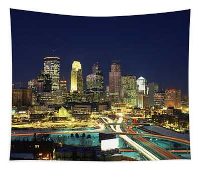 Buildings Lit Up At Night In A City Tapestry
