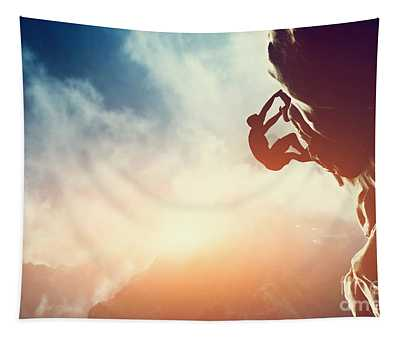 A Silhouette Of Man Climbing On Rock Mountain Tapestry