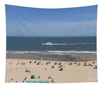 A Touring Speedboat Passes By Shore In Ocean City Maryland Tapestry