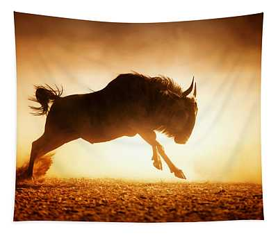 Blue Wildebeest Running In Dust Tapestry