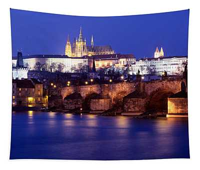 Bridge Across A River Lit Up At Night Tapestry