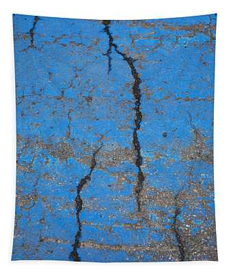 Close Up Of Cracks On A Blue Painted Tapestry