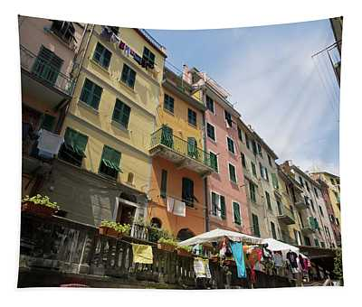 Colorful Buildings With Clothes Hanging Tapestry