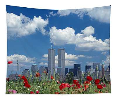 Flowers In A Park With Buildings Tapestry