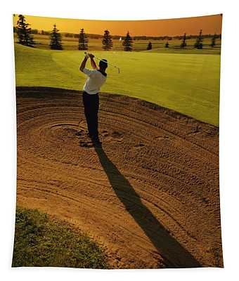 Golfer Taking A Swing From A Golf Bunker Tapestry