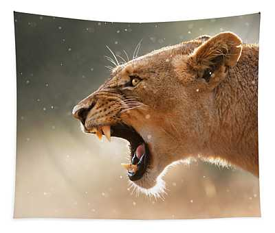 Lioness Displaying Dangerous Teeth In A Rainstorm Tapestry