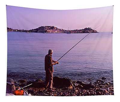 Man Fishing At The Coast, Portoferraio Tapestry