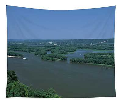 River Flowing Through A Landscape Tapestry