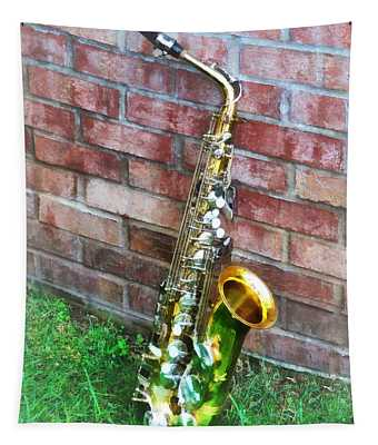 Saxophone Against Brick Tapestry