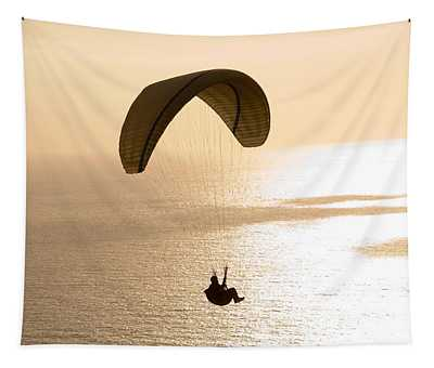 Silhouette Of A Paraglider Flying Tapestry